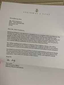 "A letter to Julie Coucheron from Steinway where she received the award for ""Top Theacher Award"""