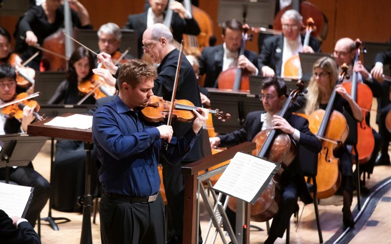 Concertmaster David Coucheron solos in Beethoven's Violin Concerto with the Atlanta Symphony Orchestra, led by music director Robert Spano. (credit: Jeff Roffman)