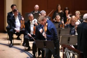 David plays violin with orchestra